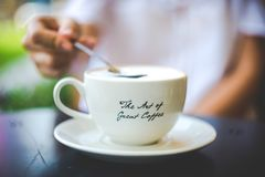 The Art of a Great Cofee. Represents a cup of coffee with a message on it royalty free stock image