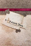 Art greeting card on vintage background (heart, old paper, fabri Royalty Free Stock Image