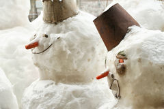Art group of snowmen on the street Stock Image