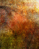 Art grunge background in red, orange, brown, green and yellow colors Stock Photos