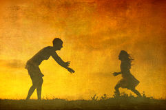 Art grunge background - silhouettes of mother and daughter at summer sunset Stock Photo
