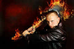 Art, a guy with a burning guitar Royalty Free Stock Images