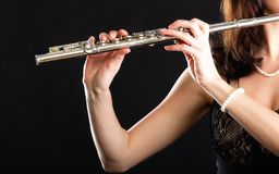Art. Hands of flutist flaustist musician playing flute Stock Photography
