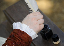 The Art of Handwriting. With Ink & Feather at Renaissance Festival Faire Stock Photo