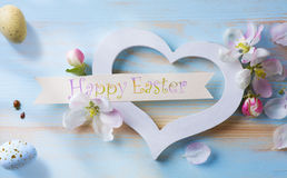 Art happy Easter day. Easter eggs and spring flowers royalty free stock photo