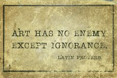 Ignorance LP. Art has no enemy except ignorance - ancient Latin proverb printed on grunge vintage cardboard Royalty Free Stock Photo