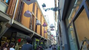 Art installation in an alleyway in Parma. July 2018. Art installation in an alleyway. These are lamps for lamps installed on street lights. July 2018 in Parma stock footage