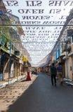 Art installation over a street in Goa, india. Goa, India - Dec 18, 2018: An art installation as part of the Serendipity Art Festival in Goa, India. The cutout royalty free stock photo