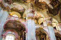 Art of interiors of St.Nicholas Church in Prague Stock Photography