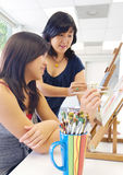 Art Lesson. Student and teacher during painting lesson Royalty Free Stock Photo