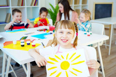 Art lesson in kindergarten. Kids painting on an art class at school stock image