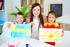 Art lesson in kindergarten. Kids painting on an art class at school royalty free stock photo