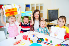 Art lesson in kindergarten. Kids painting on an art class at school royalty free stock image