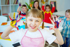 Art lesson in kindergarten. Kids painting on an art class at school royalty free stock images