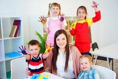 Art lesson in kindergarten. Kids painting on an art class at school stock photo