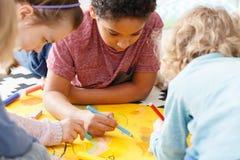 Art lesson in school. Young children having fun during art lesson in school Royalty Free Stock Photos