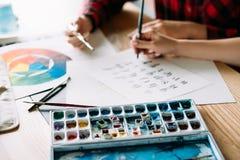 Art lettering class brush calligraphy alphabet. Art school lettering classes. creative handwriting courses. brush calligraphy alphabet. student and teacher stock image