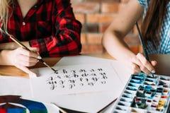 Art lettering class brush calligraphy alphabet. Art school lettering classes. creative handwriting courses. brush calligraphy alphabet. student and teacher royalty free stock images