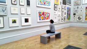 Art lover viewing art works in Royal Academy Stock Photos