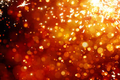Art magic Christmas Background. Golden Holiday Abstract Glitter Defocused Background With Blinking Stars Stock Image