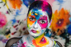 Art make up flowers. Portrait of beautiful young girl woman lady model painting canvas crazy art painting expressionism. Bright creative makeup, expressive eyes Stock Images