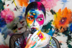 Art make up flowers. Portrait of beautiful young girl woman lady,model painting canvas art painting expressionism. Bright creative makeup expressive eyes paint Stock Image