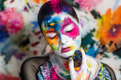 Art make up flowers. Portrait of beautiful young girl woman lady model painting canvas art painting expressionism. Bright creative makeup, expressive eyes, paint Stock Images