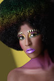 Art of makeup. Colorful decorative makeup of girl in afro wig Stock Images