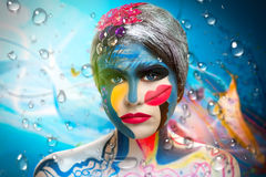 Art makeup. Surrealistic painting on the face of a beautiful young girl. The world of fantasy, illusions, hallucinations. The artist created a new underwater Royalty Free Stock Image
