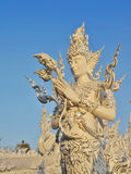 The art male deity sculpture at white temple Wat rongkhun . Stock Photo