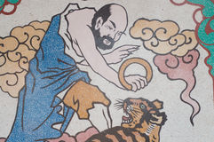 Mural painting Art man and tiger wall and wallpaper background Stock Image