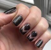 Nails. Art manicure black polish painted fingers stock photography