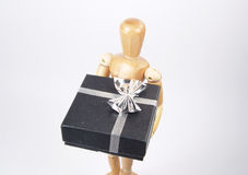 Art Mannequin Holding Gift Stock Images