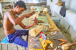 The art of mask making. AMBALANGODA, SRI LANKA - DECEMBER 5, 2016: The artisan carves the traditional wooden masks in the workshop of the Mask Museum, on royalty free stock photography
