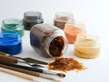 Art material. Powder pigments and laquer flakes on a white background stock photos