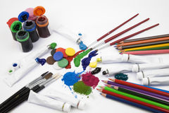 Art Materials. Various art materials: brushes, paint and coloured pencils Royalty Free Stock Image