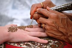 The Art of Mehndi. Mehndi or 'Mehendi' or henna is a paste that is bought in a cone-shaped tube and is made into designs for men and women. The use of mehndi and royalty free stock photos