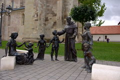 Art Metal. Metal people, monk and children, the concept of Metal people pictures of Romania, the emotions of the body, against the walls of the church, shows the Stock Photos