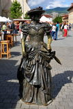 Art Metal. Performance of metal, a woman with an umbrella, body language, going for a walk, a picture taken in Romania, hike, sunny day, medieval women dress Stock Images