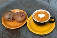 Art milk mocha coffee and muffin Stock Photo