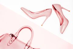 Beauty, Art Minimal fashion concept. pink nude female shoes on white background. Flat lay, top view trendy fashion feminine backgr. Art Minimal fashion concept Royalty Free Stock Photography