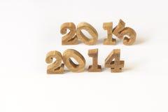 Art mit 2014 und 2015 hölzerne Zahlen Stockfotografie