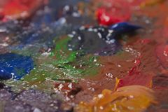 Art multi colored mixed paints on palette. royalty free stock images