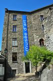 Art Museum Sion. Museum of fine arts in the old town of Sion, Switzerland. The blues in the windows, the giant poster and the sky appear to work well together Stock Photography