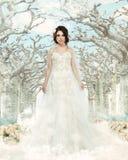 Art. Nostalgic Bride in Beautiful White Dress standing in Fabulous Alley Stock Photo