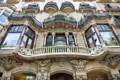 Art Nouveau building facade in Barcelona, Spain. Detail of an Art Nouveau building facade in Barcelona, Spain with a curved balcony between symmetrical windows Royalty Free Stock Image