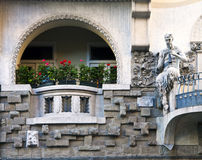 Art nouveau building facade with faun playing flute Stock Images