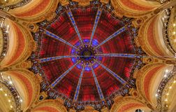 Art Nouveau decor and stained glass dome windows of the flagship Galeries Lafayette iconic French department store in Paris France. Paris, France - January 21 royalty free stock photo