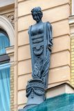 Art Nouveau (Jugendstil) style facade woman sculpture in Saint-Petersburg, Russia. Bronze woman sculpture on the facade of Art Nouveau (Jugendstil) style royalty free stock image