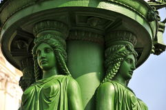 Art Nouveau Lamp Post, Prague. Close-up of Caryatid Figures in Art Nouveau-style on a 1900`s Prague Lamp-post on Hradčany Square Royalty Free Stock Photo